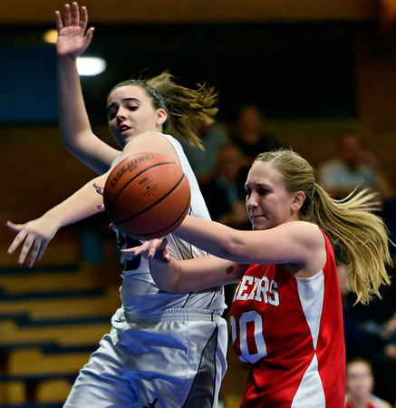 """Longmont Christian's Allison Cochran, left, and Faith Baptist's Jenny King battle for a rebound during the game at the St. Vrain Memorial Building in Longmont on Friday, Nov. 30, 2012. Faith Baptist beat Longmont Christian 26-25. For more photos visit  <a href=""""http://www.BoCoPreps.com"""">http://www.BoCoPreps.com</a>.<br /> (Greg Lindstrom/Times-Call)"""