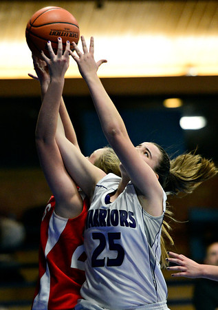 """Longmont Christian's Allison Cochran (25) and Faith Baptist's Jenny King battle for a rebound during the game at the St. Vrain Memorial Building in Longmont on Friday, Nov. 30, 2012. Faith Baptist beat Longmont Christian 26-25. For more photos visit  <a href=""""http://www.BoCoPreps.com"""">http://www.BoCoPreps.com</a>.<br /> (Greg Lindstrom/Times-Call)"""