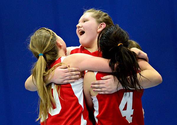 "Faith Baptist players, left to right, Jenny King, Jasmine Biesanz and Tiffany Calvog celebrate a comeback victory against Longmont Christian during the game at the St. Vrain Memorial Building in Longmont on Friday, Nov. 30, 2012. Faith Baptist won 26-25. For more photos visit  <a href=""http://www.BoCoPreps.com"">http://www.BoCoPreps.com</a>.<br /> (Greg Lindstrom/Times-Call)"