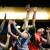 """Players stretch for a rebound during the game at the St. Vrain Memorial Building in Longmont on Friday, Nov. 30, 2012. Faith Baptist beat Longmont Christian 26-25. For more photos visit  <a href=""""http://www.BoCoPreps.com"""">http://www.BoCoPreps.com</a>.<br /> (Greg Lindstrom/Times-Call)"""