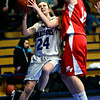 """Longmont Christian's Lizzie Ehr (24) goes up for a shot over Faith Baptist's Hailey Schulman during the game at the St. Vrain Memorial Building in Longmont on Friday, Nov. 30, 2012. Faith Baptist beat Longmont Christian 26-25. For more photos visit  <a href=""""http://www.BoCoPreps.com"""">http://www.BoCoPreps.com</a>.<br /> (Greg Lindstrom/Times-Call)"""