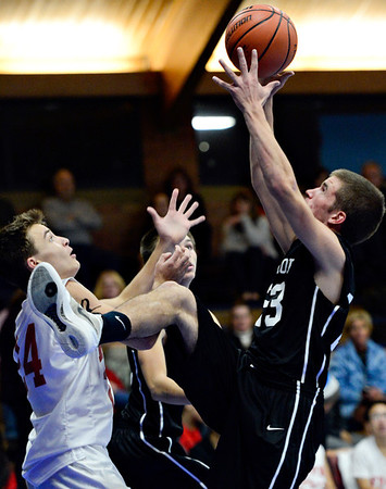 "Longmont Christian's Joe Leetch (23) grabs a rebound over Faith Baptist's Adrian Pavlov (24) during the game at the St. Vrain Memorial Building in Longmont on Friday, Nov. 30, 2012. Longmont Christian won 66-46. For more photos visit  <a href=""http://www.BoCoPreps.com"">http://www.BoCoPreps.com</a>.<br /> (Greg Lindstrom/Times-Call)"