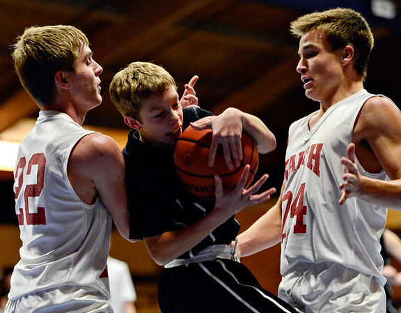 """Longmont Christian's Cade Martin (25) tries to control a ball as he is defended by Faith Baptist's Anthony Pavlov (22) and Adrian Pavlov (24) during the game at the St. Vrain Memorial Building in Longmont on Friday, Nov. 30, 2012. Longmont Christian won 66-46. For more photos visit  <a href=""""http://www.BoCoPreps.com"""">http://www.BoCoPreps.com</a>.<br /> (Greg Lindstrom/Times-Call)"""