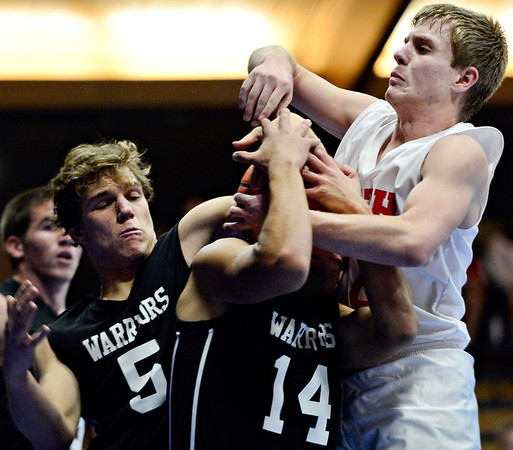 """Longmont Christian's Caleb Flowers (5) Aaron Rodarte (14) and Faith Baptist's Anthony Pavlov, right, compete for a rebound during the game at the St. Vrain Memorial Building in Longmont on Friday, Nov. 30, 2012.  For more photos visit  <a href=""""http://www.BoCoPreps.com"""">http://www.BoCoPreps.com</a>.<br /> (Greg Lindstrom/Times-Call)"""