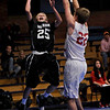 Longmont Christian's player Cade Martin (25) goes up for a basket against Faith Baptist player, Anthony Pavlov (22) during the Longmont Christian vs. Faith Baptist basketball game at the St. Vrain Memorial Building, Friday, Nov. 30, 2012. Longmont Christian won 66-48.<br /> (Elaine Cromie/For the Times-Call)
