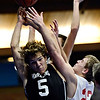 """Longmont Christian's Caleb Flowers (5) battles for a rebound against Faith Baptist's Anthony Pavlov (22) during the game at the St. Vrain Memorial Building in Longmont on Friday, Nov. 30, 2012. Longmont Christian won 66-46. For more photos visit  <a href=""""http://www.BoCoPreps.com"""">http://www.BoCoPreps.com</a>.<br /> (Greg Lindstrom/Times-Call)"""