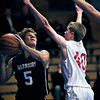 Longmont Christian player Caleb Flowers (5) looks to score against Faith Baptist player, Jared Lotz (40) during the Longmont Christian vs. Faith Baptist game at the St. Vrain Memorial Building, Friday, Nov. 30, 2012. Longmont Christian won 66 to 48<br /> (Elaine Cromie/For the Times-Call)