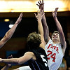 """Faith Baptist's Adrian Pavlov (24) tries to shoot over Longmont Christian's Caleb Flowers (5) during the game at the St. Vrain Memorial Building in Longmont on Friday, Nov. 30, 2012. Longmont Christian won 66-46. For more photos visit  <a href=""""http://www.BoCoPreps.com"""">http://www.BoCoPreps.com</a>.<br /> (Greg Lindstrom/Times-Call)"""