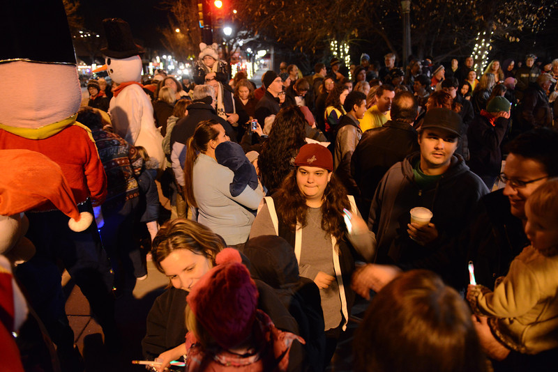 """The """"Hooray, Hooray for the Holidays"""" downtown tree lighting ceremony Friday night Nov. 23, 2012 at Sixth Avenue and Main Street. Hundreds were entertained with caroling, an ice-carved sleigh, and a host of holiday characters as the 17-foot tree was lit.(Lewis Geyer/Times-Call)"""