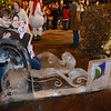 """Daniel Watson, Kimberl Parreira, and Liana Parreira, who was nine days old, have their photo taken in an ice-carved sleigh during the """"Hooray, Hooray for the Holidays"""" downtown tree lighting ceremony Friday night Nov. 23, 2012 at Sixth Avenue and Main Street. Hundreds were entertained with caroling and a host of holiday characters as the 17-foot tree was lit.(Lewis Geyer/Times-Call)"""
