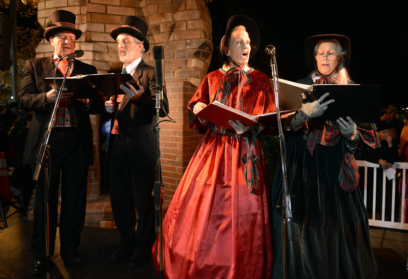 """The Jesters Court Singers, including from left, Bill Campbell, Scott Moore, Mary Lou Moore and Sally Campbell, perform during the """"Hooray, Hooray for the Holidays"""" downtown tree lighting ceremony Friday night Nov. 23, 2012 at Sixth Avenue and Main Street. Hundreds were entertained with caroling, an ice-carved sleigh, and a host of holiday characters as the 17-foot tree was lit.(Lewis Geyer/Times-Call)"""