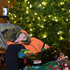 "Everett Johnson, 2, sleeps after the ""Hooray, Hooray for the Holidays"" downtown tree lighting ceremony Friday night Nov. 23, 2012 at Sixth Avenue and Main Street. Hundreds were entertained with caroling, an ice-carved sleigh, and a host of holiday characters as the 17-foot tree was lit. (Lewis Geyer/Times-Call)"