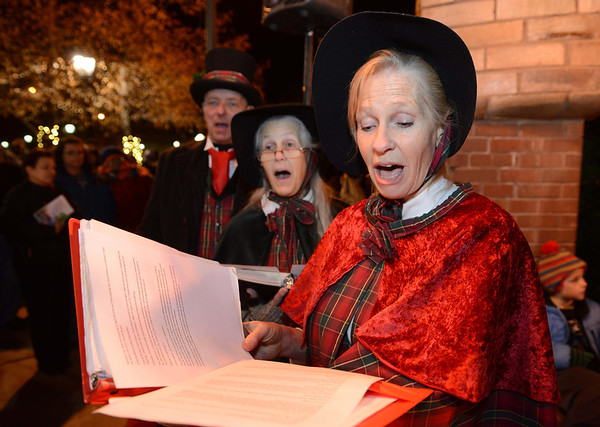 "The Jesters Court Singers, including from left, Bill Campbell, Sally Campbell, and Mary Lou Moore perform during the ""Hooray, Hooray for the Holidays"" downtown tree lighting ceremony Friday night Nov. 23, 2012 at Sixth Avenue and Main Street. Hundreds were entertained with caroling, an ice-carved sleigh, and a host of holiday characters as the 17-foot tree was lit.(Lewis Geyer/Times-Call)"