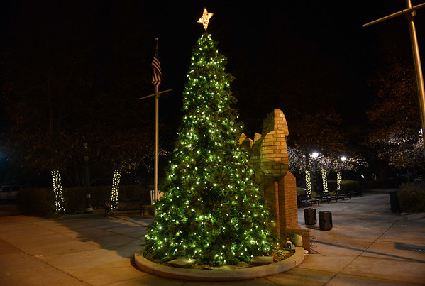 """The 17-foot tall tree stands by itself after the """"Hooray, Hooray for the Holidays"""" downtown tree lighting ceremony Friday night Nov. 23, 2012 at Sixth Avenue and Main Street. (Lewis Geyer/Times-Call)"""