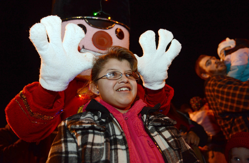 """Abby Ponce, 12, has her photo taken with The Nutcracker during the """"Hooray, Hooray for the Holidays"""" downtown tree lighting ceremony Friday night Nov. 23, 2012 at Sixth Avenue and Main Street.  (Lewis Geyer/Times-Call)"""