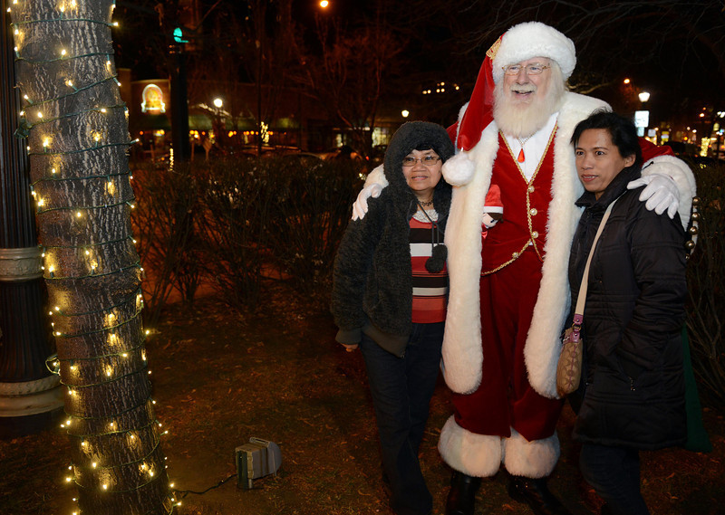 """Virginia Bott, left, and her niec Rita Tingley have their photo taken with Santa Claus during the """"Hooray, Hooray for the Holidays"""" downtown tree lighting ceremony Friday night Nov. 23, 2012 at Sixth Avenue and Main Street. Hundreds were entertained with caroling, an ice-carved sleigh, and a host of holiday characters as the 17-foot tree was lit.(Lewis Geyer/Times-Call)"""