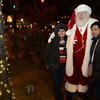 "Virginia Bott, left, and her niec Rita Tingley have their photo taken with Santa Claus during the ""Hooray, Hooray for the Holidays"" downtown tree lighting ceremony Friday night Nov. 23, 2012 at Sixth Avenue and Main Street. Hundreds were entertained with caroling, an ice-carved sleigh, and a host of holiday characters as the 17-foot tree was lit.(Lewis Geyer/Times-Call)"