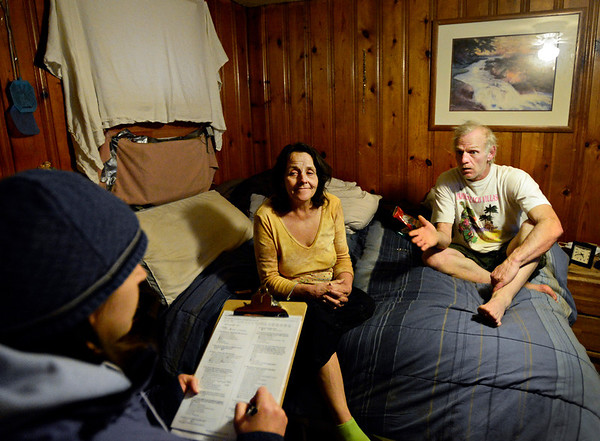 "Volunteer Gina Walker, far left, conducts Metropolitan Denver Homeless Initiative's point-in-time survey with Tony Giallella, right, and his wife Terry Childs at the Bar-L Motel in Longmont on Monday, Jan. 28, 2013. The survey provides a snapshot of homelessness in seven counties along the Front Range. For more photos visit  <a href=""http://www.TimesCall.com"">http://www.TimesCall.com</a>.<br /> (Greg Lindstrom/Times-Call)"