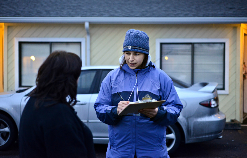"""Volunteer Gina Walker, right, conducts Metropolitan Denver Homeless Initiative's point-in-time survey with Emily Pritchard outside the Countrywood Inn & RV Park in Longmont on Monday, Jan. 28, 2013. The survey provides a snapshot of homelessness in seven counties along the Front Range. For more photos visit  <a href=""""http://www.TimesCall.com"""">http://www.TimesCall.com</a>.<br /> (Greg Lindstrom/Times-Call)"""