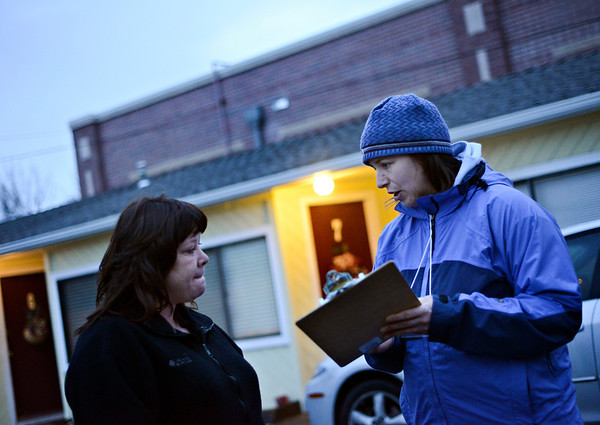 "Volunteer Gina Walker, right, conducts Metropolitan Denver Homeless Initiative's point-in-time survey with Emily Pritchard outside the Countrywood Inn & RV Park in Longmont on Monday, Jan. 28, 2013. The survey provides a snapshot of homelessness in seven counties along the Front Range. For more photos visit  <a href=""http://www.TimesCall.com"">http://www.TimesCall.com</a>.<br /> (Greg Lindstrom/Times-Call)"