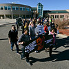 Sergio King, left, and his sister Chantal hold a sign and lead a group of about 75 people on a walk around Silver Creek High School during the Dr. Martin Luther King Marade (March/Parade) and Celebration Program on Monday, Jan. 21, 2013.<br /> (Greg Lindstrom/Times-Call)