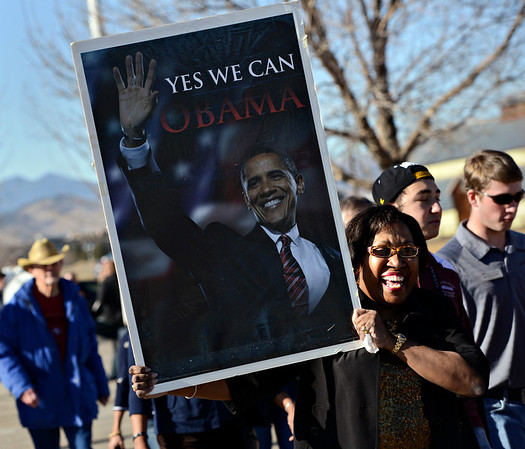Madelyn Woodley, event coordinator of the Dr. Martin Luther King Marade (March/Parade) and Celebration Program, holds a sign of President Barack Obama during a rally at Silver Creek High School in Longmont on Monday, Jan. 21, 2013. <br /> (Greg Lindstrom/Times-Call)