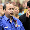 Adolfo Carrillo takes an oath to become a U.S. citizen during a Naturalization Ceremony at Twin Peaks Charter Academy on Wednesday, Dec. 12, 2012.<br /> (Greg Lindstrom/Times-Call)