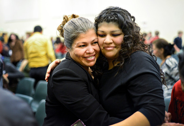Maria Avila, left, hugs her daughter Sandra Torres after the Naturalization Ceremony at Twin Peaks Charter Academy on Wednesday, Dec. 12, 2012.  Avila, originally from Mexico, became a U.S. citizen at the ceremony.<br /> (Greg Lindstrom/Times-Call)