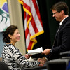 Parvin Masiah, originally from Iran, receives her certificate of citizenship from Twin Peaks Charter Academy principal B.J. Buchmann during a Naturalization Ceremony at Twin Peaks Charter Academy in Longmont on Wednesday, Dec. 12, 2012.<br /> (Greg Lindstrom/Times-Call)