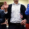 Citizens take an oath to become a U.S. citizen during a Naturalization Ceremony at Twin Peaks Charter Academy on Wednesday, Dec. 12, 2012.<br /> (Greg Lindstrom/Times-Call)