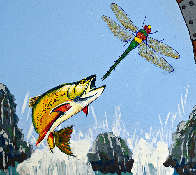 "A trout leaps for a glitter-painted dragonfly in Keith Deppe's mural at the Longmont Public Library on Sunday, Jan. 6, 2013. Deppe added glitter to some of his mural after he noticed many children use it in their work. For more photos and a video visit  <a href=""http://www.TimesCall.com"">http://www.TimesCall.com</a>. <br /> (Greg Lindstrom/Times-Call)"