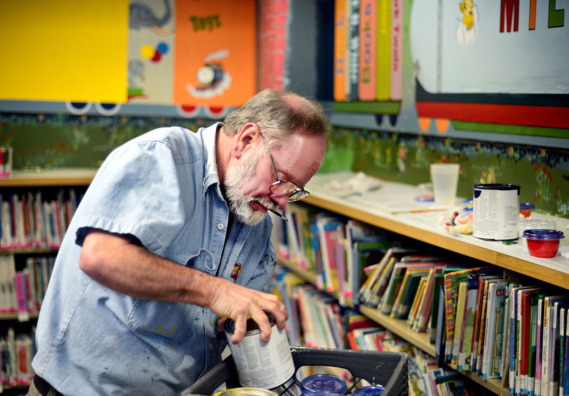 "Keith Deppe looks for paints while working on his mural at the Longmont Public Library on Sunday, Jan. 6, 2013. For more photos and a video visit  <a href=""http://www.TimesCall.com"">http://www.TimesCall.com</a>. <br /> (Greg Lindstrom/Times-Call)"