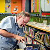 """Keith Deppe looks for paints while working on his mural at the Longmont Public Library on Sunday, Jan. 6, 2013. For more photos and a video visit  <a href=""""http://www.TimesCall.com"""">http://www.TimesCall.com</a>. <br /> (Greg Lindstrom/Times-Call)"""