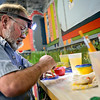 """Keith Deppe mixes colors while working on his train mural at the Longmont Public Library on Sunday, Jan. 6, 2013. For more photos and a video visit  <a href=""""http://www.TimesCall.com"""">http://www.TimesCall.com</a>. <br /> (Greg Lindstrom/Times-Call)"""