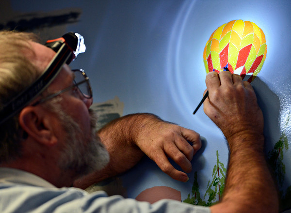 "Keith Deppe paints a hot-air balloon on his mural at the Longmont Public Library on Sunday, Jan. 6, 2013. For more photos and a video visit  <a href=""http://www.TimesCall.com"">http://www.TimesCall.com</a>. <br /> (Greg Lindstrom/Times-Call)"