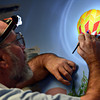 """Keith Deppe paints a hot-air balloon on his mural at the Longmont Public Library on Sunday, Jan. 6, 2013. For more photos and a video visit  <a href=""""http://www.TimesCall.com"""">http://www.TimesCall.com</a>. <br /> (Greg Lindstrom/Times-Call)"""