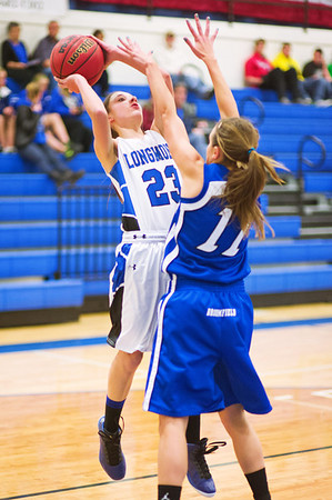 Longmont's #23, Kathryn Schell, puts up a shot as Broomfield's #11, Katie Croell, defends during their game at Longmont High School on Tuesday evening, January 15th, 2013.<br /> <br /> Photo by: Jonathan Castner/For the Times-Call
