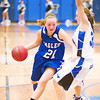 Broomfield's #21, Nicole Lehrer, drives to the hoop as Longmont's #32, Megan Tulenko, defends during their game at Longmont High School on Tuesday evening, January 15th, 2013.<br /> <br /> Photo by: Jonathan Castner/For the Times-Call