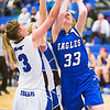 Broomfield's #33, Haylee Albrecht, puts up a shot and is fouled by Longmont's #3, Gabriella Fallon, during their game at Longmont High School on Tuesday evening, January 15th, 2013.<br /> <br /> Photo by: Jonathan Castner/For the Times-Call