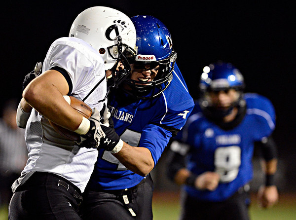 "Longmont's Isaac Sprecher brings down Greeley Central's Andreu Cotto during the game at Longmont High School on Friday, Nov. 2, 2012. For more photos visit  <a href=""http://www.BoCoPreps.com"">http://www.BoCoPreps.com</a>.<br /> (Greg Lindstrom/Times-Call)"