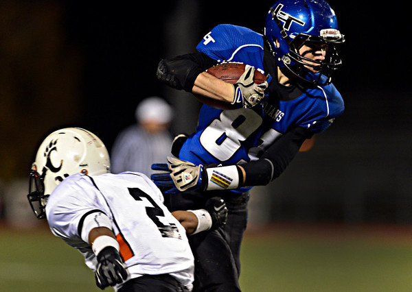 """Longmont's Eli Sullivan (81) breaks through Greeley Central's Anthony Perez (2) during the game at Longmont High School on Friday, Nov. 2, 2012. For more photos visit  <a href=""""http://www.BoCoPreps.com"""">http://www.BoCoPreps.com</a>.<br /> (Greg Lindstrom/Times-Call)"""