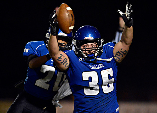 """Longmont's Joe Lopez (36) and Jamal Mangelsen (20) celebrate after Lopez blocked a Greeley Central punt and recovered the ball in the endzone for a touchdown during the game at Longmont High School on Friday, Nov. 2, 2012. For more photos visit  <a href=""""http://www.BoCoPreps.com"""">http://www.BoCoPreps.com</a>.<br /> (Greg Lindstrom/Times-Call)"""