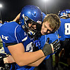 """Longmont's Joe Lopez, left, and Ian Pomper embrace after a blocked punt by Lopez during the game at Longmont High School on Friday, Nov. 2, 2012. Longmont beat Greeley Central 42-25. For more photos visit  <a href=""""http://www.BoCoPreps.com"""">http://www.BoCoPreps.com</a>.<br /> (Greg Lindstrom/Times-Call)"""