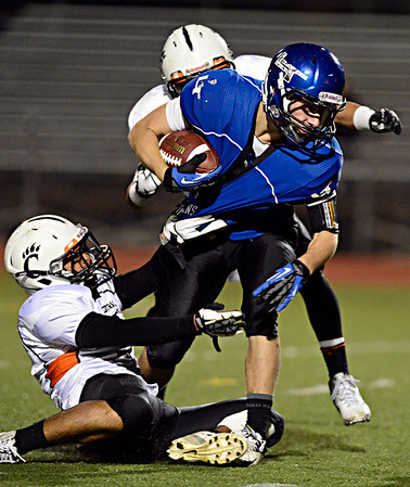 "Longmont's Drake Greeott is pulled down by Greeley Central's Julio Meraz during the game at Longmont High School on Friday, Nov. 2, 2012. Longmont beat Greeley Central 42-25. For more photos visit  <a href=""http://www.BoCoPreps.com"">http://www.BoCoPreps.com</a>.<br /> (Greg Lindstrom/Times-Call)"