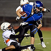 """Longmont's Drake Greeott is pulled down by Greeley Central's Julio Meraz during the game at Longmont High School on Friday, Nov. 2, 2012. Longmont beat Greeley Central 42-25. For more photos visit  <a href=""""http://www.BoCoPreps.com"""">http://www.BoCoPreps.com</a>.<br /> (Greg Lindstrom/Times-Call)"""