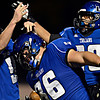 """Longmont's Ian Pomper (9), Joe Lopez (36) and Jamal Mangelsen (20) celebrate after Lopez blocked a Greeley Central punt and recovered the ball in the endzone for a touchdown during the game at Longmont High School on Friday, Nov. 2, 2012. For more photos visit  <a href=""""http://www.BoCoPreps.com"""">http://www.BoCoPreps.com</a>.<br /> (Greg Lindstrom/Times-Call)"""