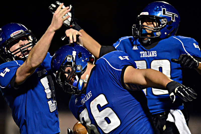 "Longmont's Ian Pomper (9), Joe Lopez (36) and Jamal Mangelsen (20) celebrate after Lopez blocked a Greeley Central punt and recovered the ball in the endzone for a touchdown during the game at Longmont High School on Friday, Nov. 2, 2012. For more photos visit  <a href=""http://www.BoCoPreps.com"">http://www.BoCoPreps.com</a>.<br /> (Greg Lindstrom/Times-Call)"