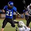 "Longmont's Logan Goodner (21) tries to get past Greeley Central's Julio Meraz (8) during the game at Longmont High School on Friday, Nov. 2, 2012. Longmont beat Greeley Central 42-25. For more photos visit  <a href=""http://www.BoCoPreps.com"">http://www.BoCoPreps.com</a>.<br /> (Greg Lindstrom/Times-Call)"