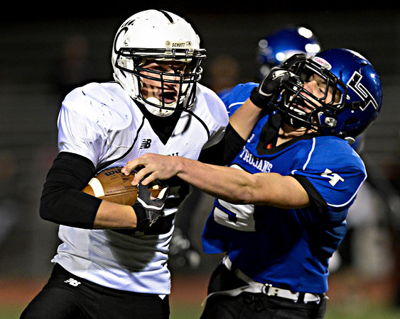 """Greeley Central's Travis Lechman is brought down by Longmont's Ian Pomper (9) during the game at Longmont High School on Friday, Nov. 2, 2012. For more photos visit  <a href=""""http://www.BoCoPreps.com"""">http://www.BoCoPreps.com</a>.<br /> (Greg Lindstrom/Times-Call)"""