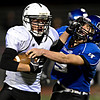 "Greeley Central's Travis Lechman is brought down by Longmont's Ian Pomper (9) during the game at Longmont High School on Friday, Nov. 2, 2012. For more photos visit  <a href=""http://www.BoCoPreps.com"">http://www.BoCoPreps.com</a>.<br /> (Greg Lindstrom/Times-Call)"